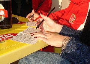 players marking off bingo cards screenshot