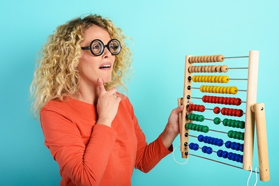 Woman Using Abacus